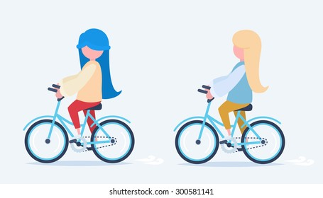 Two girls riding a colorful bicycle