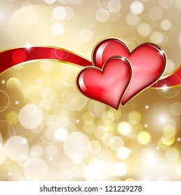 Two glass red hearts on golden background with bokeh