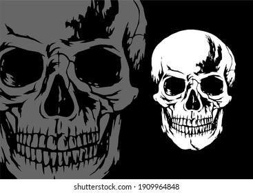 The two gray and white skull heads on black paper are pretty and scary