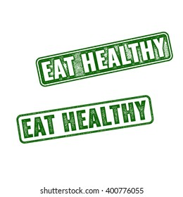 Two green realistic vector grunge rubber stamps Eat Healthy isolated on white background