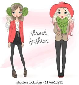 Two hand drawn beautiful cute autumn fashion girls. Vector illustration.