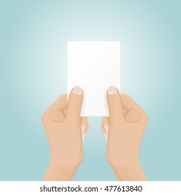 Two hands hold a business card