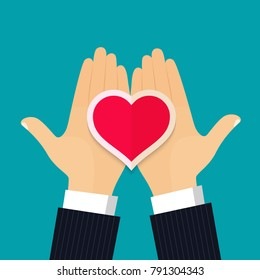 Two hands holding a heart. Valentines day. Vector flat style illustration
