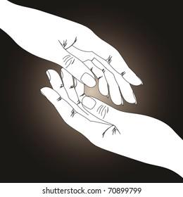 Two hands on dark background