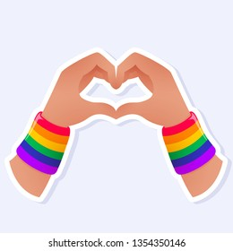 Two Hands Showing Heart Icon. LGBTQ+ related symbol in rainbow colors. Gay Pride. Raibow Community Pride Month. Love, Freedom, Support, Peace Symbol. Flat Vector Design Isolated on White Background
