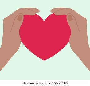 Two hands wrapped around a beautiful pink heart.