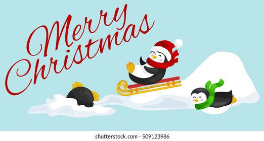 two happy cute christmas penguin in hat and scarf sledding snow ice slides on the