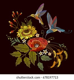 Two humming birds and sunflowers, poppies, ears of wheat embroidery on black background. Beautiful bouquet and tropical humming bird vector. Decorative floral embroidery
