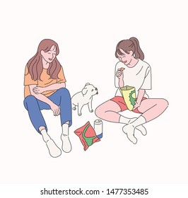 Two little girls are eating snacks sitting on the floor. A cute puppy sitting among them is watching a girl. hand drawn style vector design illustrations.