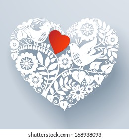 Two love birds are part of a beautiful floral lace like paper cut ornament that creates