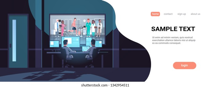 two men looking at monitors behind glass doctors group checking patient running on treadmill cardiology science dark office interior surveillance security system copy space
