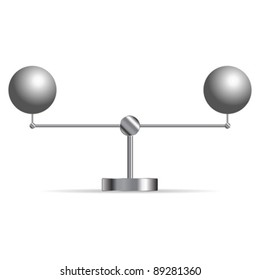 Two metallic spheres supported in a cradle over white