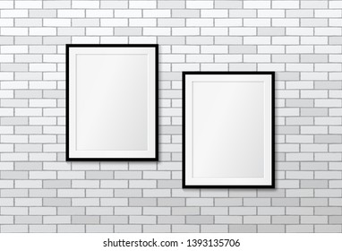 Two modern frames on white brick wall. Vector mock up. Picture frames layout