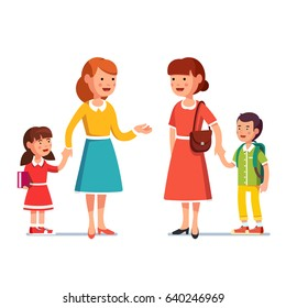 Two mothers with school first grader and kindergarten kid boy and girl meet and talking to each other, gossiping. Mum holding kid by hand.