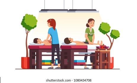 Two oriental spa salon massage therapist women massaging men lying down relaxing on table. Luxury cabinet with towels, shelves, plants. Massage room decoration, furniture. Flat vector illustration