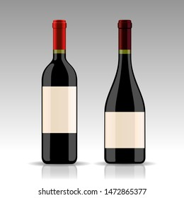 Two photo realistic red wine bottles with empty labels and red capsules, isolated on white background for label design presentatiton