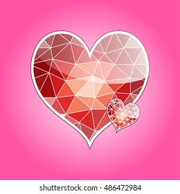 two red heart shaped diamond