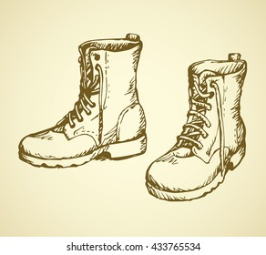 Two rough old reliable eyelets sole forces male boots isolated on white background. Freehand outline ink hand drawn picture sketchy in scribble retro cartoon style pen on paper. Closeup view