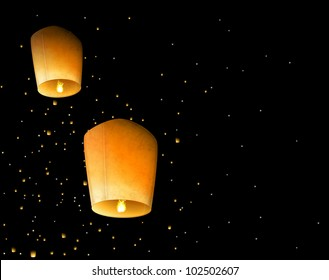 Two sky lantern in the night sky. Eps 10