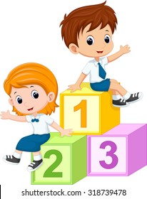 Two students sitting on the numbers blocks