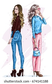 Two stylish beautiful women. Fashion girls with accessories. Hand drawn girls in fashion clothes. Fashion look. Sketch. Vector illustration.