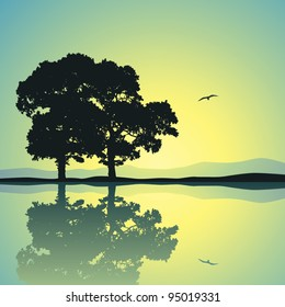 Two Trees Standing Alone with Reflection in Water