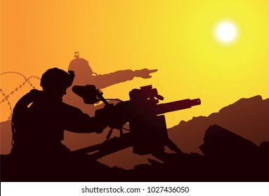 Two US soldiers shoot from an automatic grenade launcher