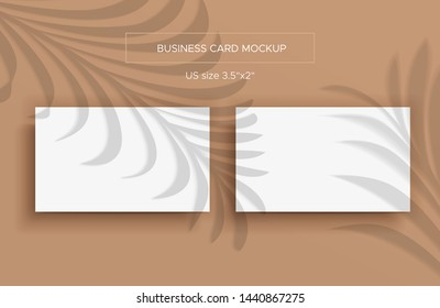 Two White Business cards Mockup. Natural lighting overlays shadows on top. Scene of Tropical Leaf Shadows from the window. A palm leaves. Photo-realistic vector illustration. Cards 2x3.5 inch.