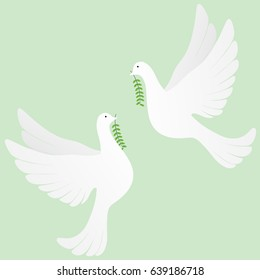Two white doves flying with olive branch on green background.