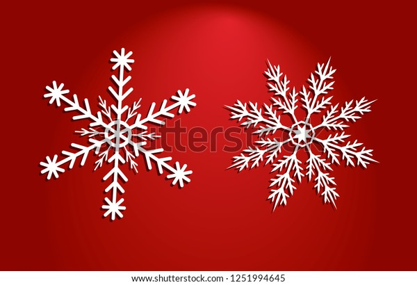 Two white vector snow flakes of different shapes on red illuminated by a semicircle background