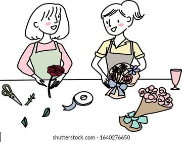 Two women working at a flower shop. Happy women attending flower arrangement workshop, making flower bouquets in a class. Two female florists working together, arranging flower bouquets in studio.