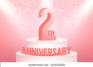 Two years anniversary celebration on pink background.
