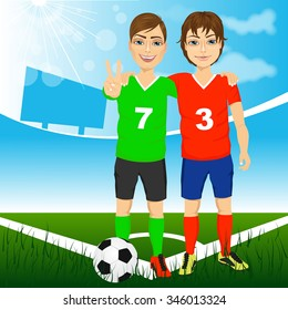 two young soccer players friends and rivals of competing teams together on a soccer field