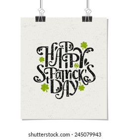 Typographic style poster for St. Patrick's Day with message Happy St. Patrick's Day. Poster design mock-up with paper clips, isolated on white.