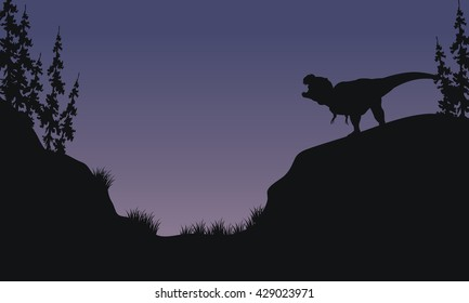 Tyranosaurus in hills scnery silhouette at the morning