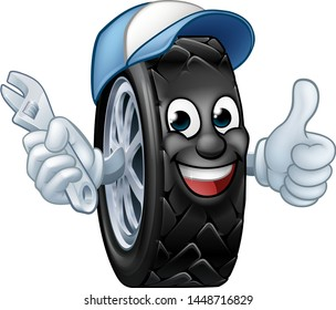 A tyre cartoon car mechanic service mascot holding a spanner and giving a thumbs up