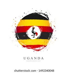 Uganda flag in the shape of a big circle. Vector illustration on a white background. Brush strokes are drawn by hand. Independence Day.