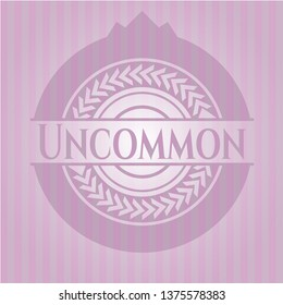 Uncommon badge with pink background
