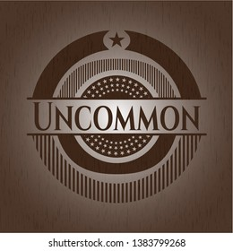 Uncommon badge with wooden background