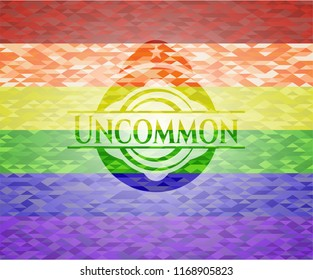 Uncommon emblem on mosaic background with the colors of the LGBT flag