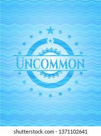 Uncommon sky blue water wave emblem.