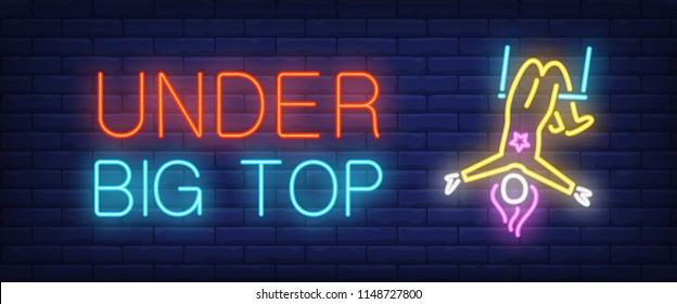 Under big top neon style banner. Text and circus acrobat on brick background. Night bright advertisement. Can be used for signs, posters, billboards