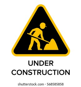 Under construction sign with man digging ground