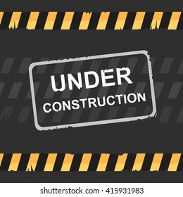 Under construction sign on dark background.