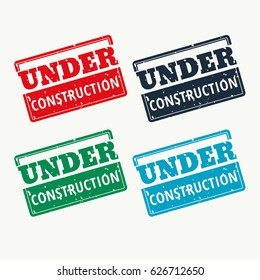 under construction sign vector in four colors