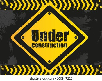 under construction signal  on grunge background with grid pattern