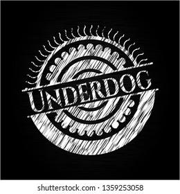 Underdog chalkboard emblem on black board