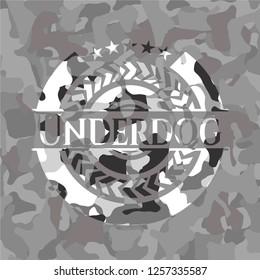 Underdog on grey camouflaged texture