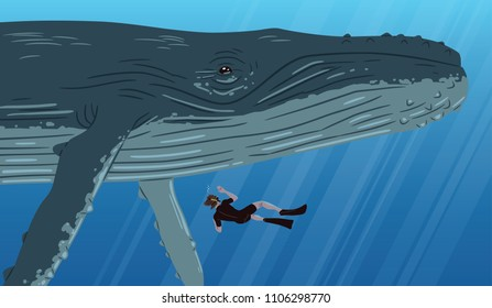 Underwater image of a man diving next to a blue whale