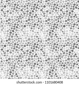 Uneven spots, spots, pebbles of different size. Seamless pattern. Abstract  dotted texture background.